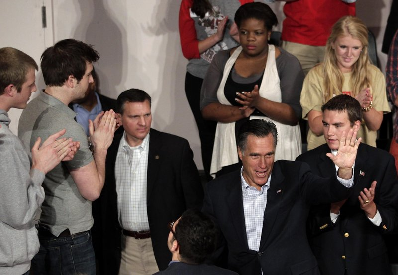 """""""I will try and unite the American people, not divide us,"""" Republican presidential candidate Mitt Romney told students at Otterbein University in Westerville, Ohio, on Friday."""
