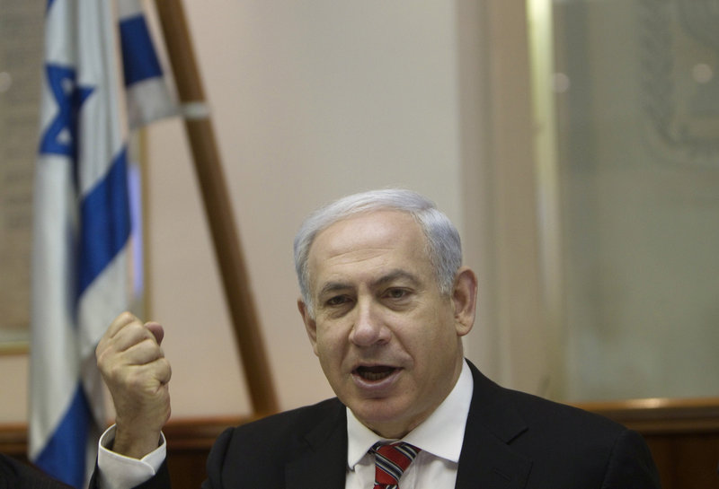 Israeli Prime Minister Benjamin Netanyahu attends the Cabinet meeting in Jerusalem Sunday. He's to consult this week with coalition partners on a new date for elections.