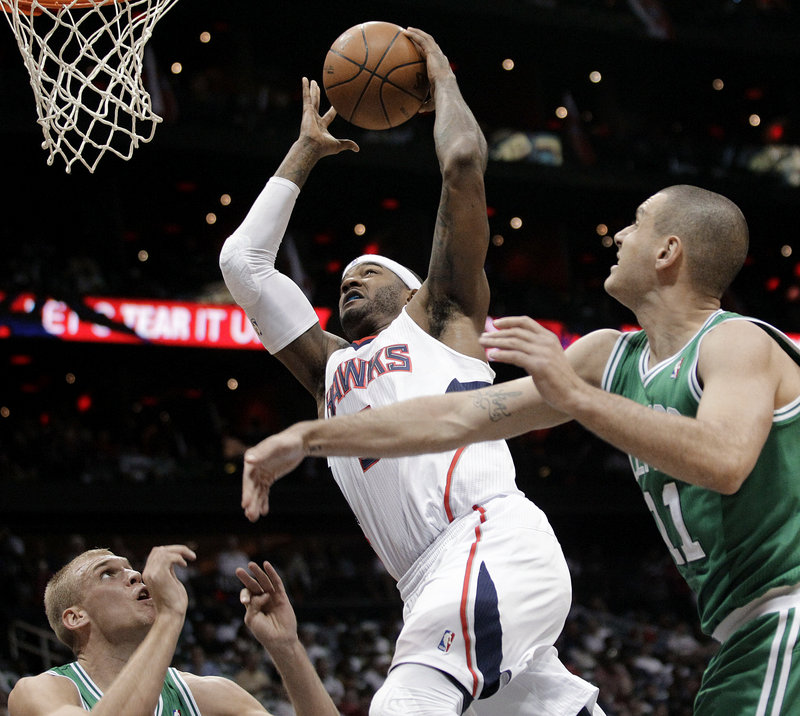 Josh Smith of the Hawks goes up for a shot in front of Sasha Pavlovic. Smith finished with 22 points and 18 rebounds, leading Atlanta to an 83-74 victory over the Celtics.