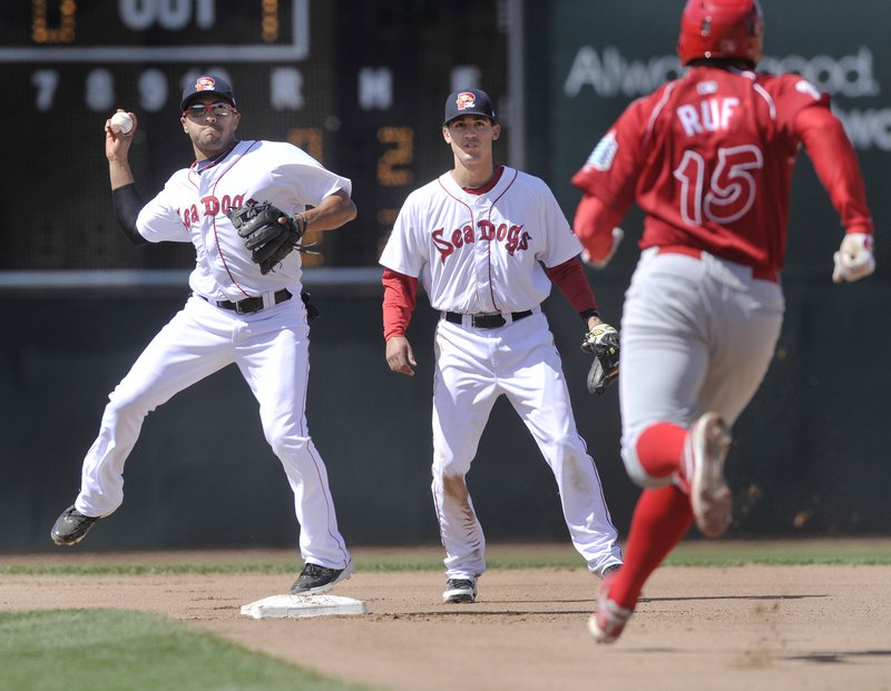 Sea Dogs second baseman Ryan Dent forces out Reading's Darin Ruf before throwing to first base to complete a double play during Portland's 9-1 win at Hadlock Field.