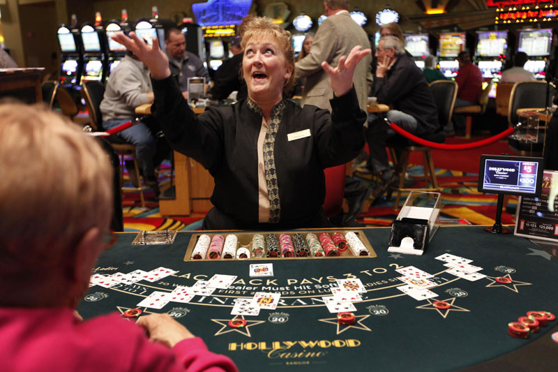 Blackjack dealer Darlene Fellis gestures after dealing a winning hand at Hollywood Slots in Bangor. Mainers in a recent survey said they want the final say in whether to expand gambling in the state.