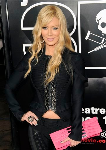 FILE - In this Oct. 13, 2010 file photo Jenna Jameson poses at a in Los Angeles. The former porn star Jameson has been arrested in Orange County for investigation of driving under the influence after she struck a light pole with her vehicle. (AP Photo/Chris Pizzello,File)
