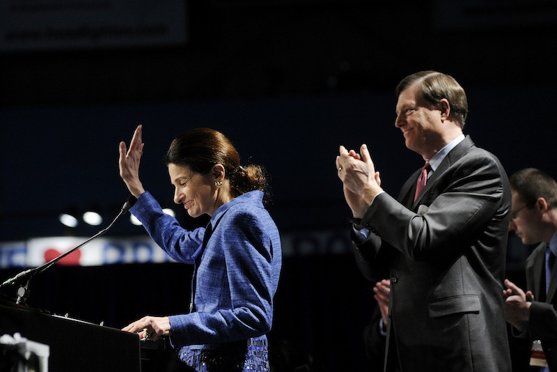 Sen. Olympia Snowe acknowledges the delegates after her speech at the Maine Republican Party State Convention on Sunday. Looking on is her husband, former Maine Gov. John McKernan.