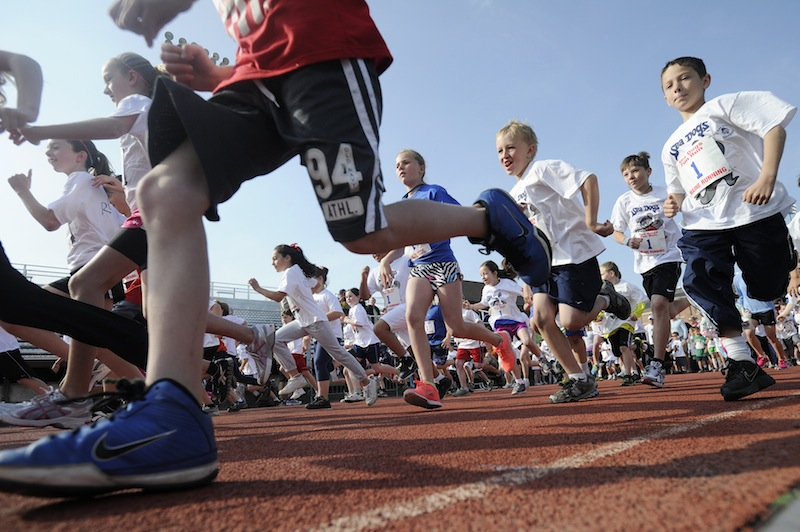 Runners make their way around the track at Fitzpatrick Staduim during the kids run as part of the Mother's Day 5K Road Race at Hadlock Field on Sunday May 13, 2012.