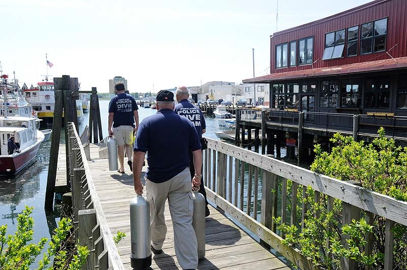 Members of the Portland police dive team assemble at the Portland water taxi ramp Monday, May 21, 2012 to begin another search for a Harvard student who went missing after a night with friends in the Old Port.