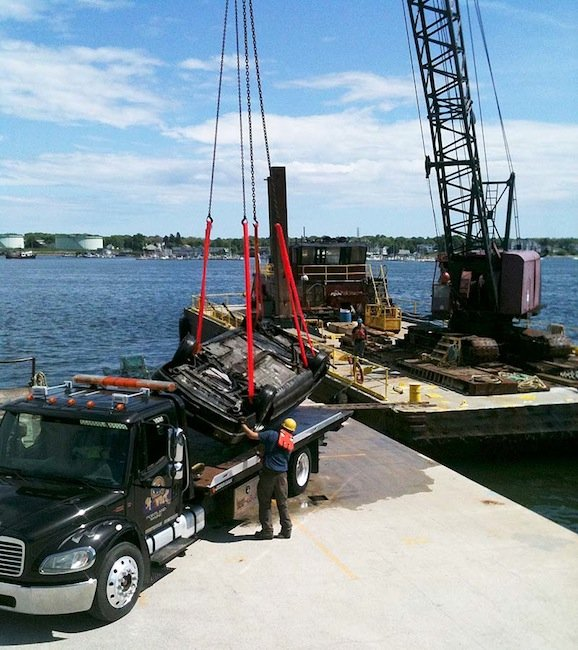 A car discovered in Portland Harbor by divers searching for missing Harvard student Nathan Bihlmaier is recovered on Wednesday, May 23, 2012.