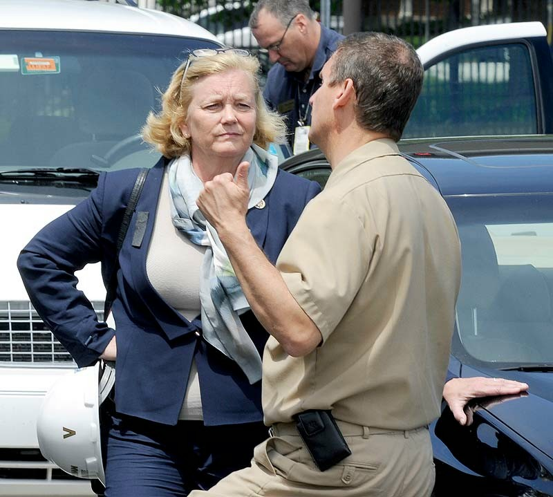 U.S. Rep. Chellie Pingree speaks with Capt. Bryant Fuller at Portsmouth Naval Shipyard in Kittery, site of a submarine fire that broke out Wednesday.