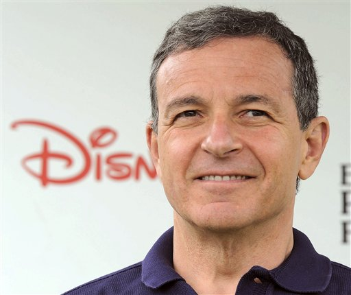 FILE - In this June 12, 2011 file photo, Robert Iger srrives at The 22nd Annual A Time for Heroes Celebrity Carnival Sponsored by Disney at Wadsworth Theater in Los Angeles. Iger is one of the top 10 highest paid CEOs at publicly held companies in America last year, according to calculations by Equilar, an executive compensation data firm, and The Associated Press. The Associated Press formula calculates an executive's total compensation during the last fiscal year by adding salary, bonuses, perks, above-market interest the company pays on deferred compensation and the estimated value of stock and stock options awarded during the year. (AP Photo/Katy Winn, File)