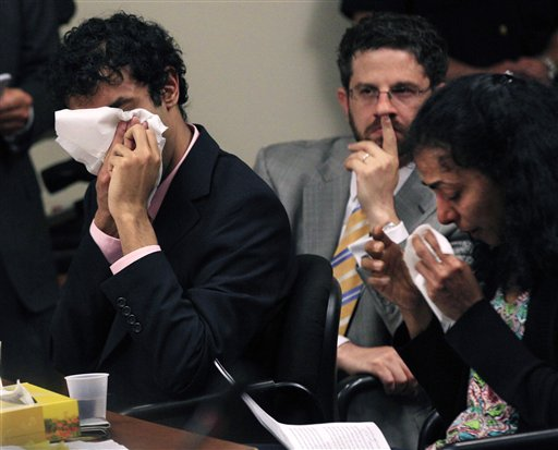 As defense attorney Philip Nettl, center, looks on Dharun Ravi, left,and his mother, Sabitha Ravi cry as she reads a statement during a sentencing hearing for Ravi in New Brunswick, N.J., Monday, May 21, 2012. Ravi, a former Rutgers University student who used a webcam to watch his roommate kiss another man days before the roommate killed himself was sentenced Monday to 30 days in jail. A judge also gave 20-year-old Dharun Ravi three years of probation. (AP Photo/Mel Evans)