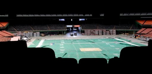 Old, wrinkled Astroturf for football lays across the floor of the Astrodome Monday, May 21, 2012, in Houston. Once touted as the Eighth Wonder of the World, the nation's first domed stadium sits quietly gathering dust and items for storage. (AP Photo/Pat Sullivan)