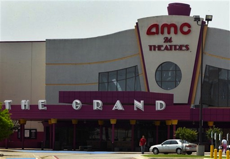 A May 11, 2005, file photo shows the exterior of the AMC Grand 24 movie theatre in Dallas, Texas. A Chinese conglomerate has announced Monday May 21, 2012 it will buy U.S. cinema chain AMC Entertainment Holdings for $2.6 billion to create the world's biggest movie theater operator. (AP Photo/Ron Heflin/file)