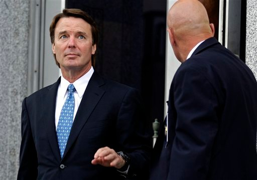 Former presidential candidate and Sen. John Edwards, left, leaves a federal courthouse in Greensboro, N.C., on Tuesday. Edwards is accused of conspiring to secretly obtain more than $900,000 from two wealthy supporters to hide his extramarital affair with Rielle Hunter and her pregnancy. He has pleaded not guilty to six charges related to violations of campaign-finance laws.