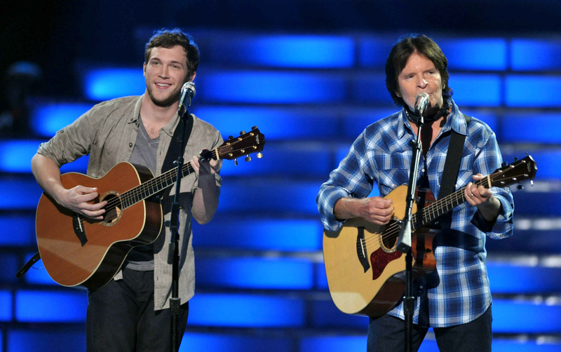 Finalist Phillip Phillips, left, and John Fogerty perform onstage at the