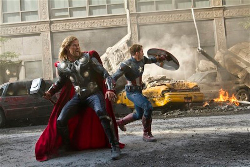 In this film image released by Disney, Chris Hemsworth portrays Thor, left, and and Chris Evans portrays Captain America in a scene from
