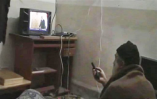 This undated image from video, seized from the walled compound of al-Qaida leader Osama bin Laden in Abbottabad, Pakistan, shows a man identified as Osama bin Laden watching President Barack Obama on his television.