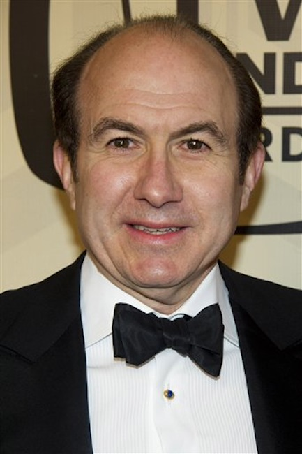 In this April 14, 2012 file photo, Viacom CEO Philippe Dauman arrives to the TV Land Awards 10th Anniversary in New York. Dauman is one of the top 10 highest paid CEOs at publicly held companies in America last year, according to calculations by Equilar, an executive compensation data firm, and The Associated Press. The Associated Press formula calculates an executive's total compensation during the last fiscal year by adding salary, bonuses, perks, above-market interest the company pays on deferred compensation and the estimated value of stock and stock options awarded during the year.(AP Photo/Charles Sykes, File) Award ceremony keytest012 Red carpet One person