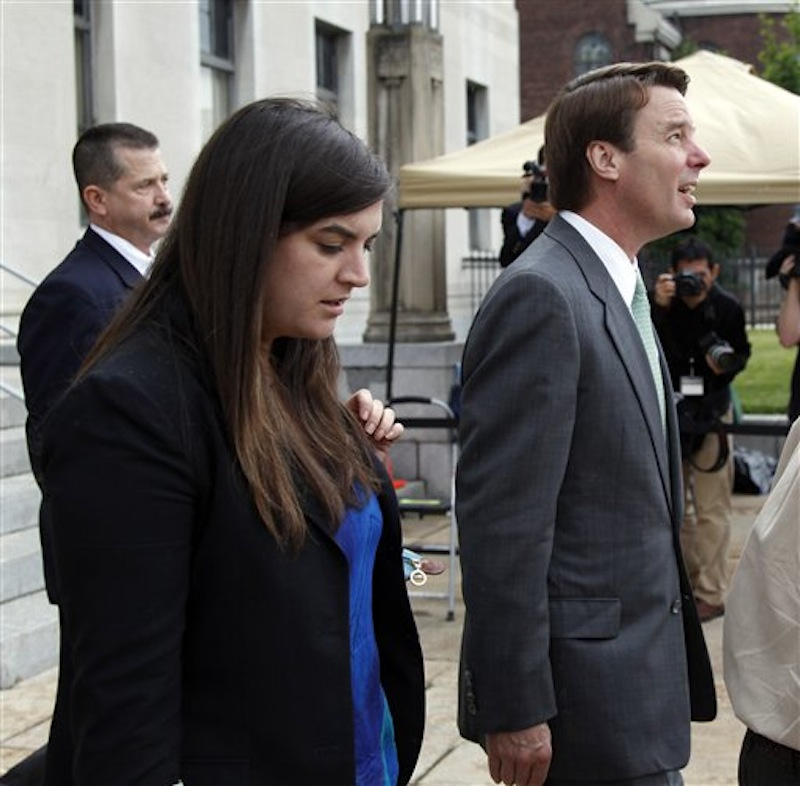 Cate Edwards looks down as she walks with her father, John Edwards as he checks the stormy skies as they both exit a federal courthouse in Greensboro, N.C., Monday, May 14, 2012. John Edwards is on trial for campaign corruption. (AP Photo/Bob Leverone)