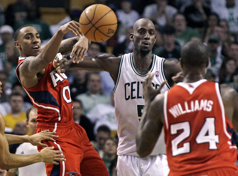 Atlanta guard Jeff Teague, left, passes off to teammate Marvin Williams against Boston's Kevin Garnett in Game 3 of the Eastern Conference quarterfinals Friday.