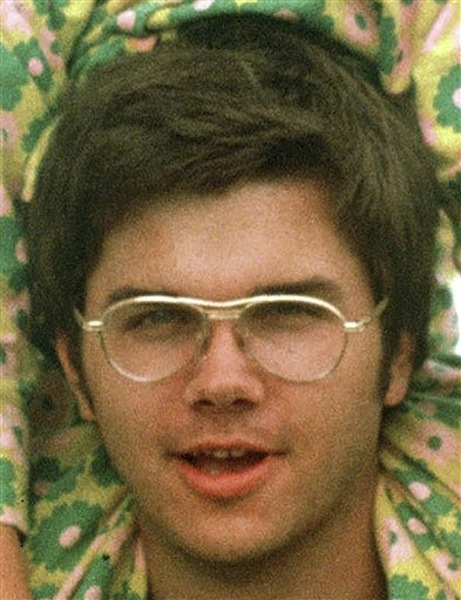 In this 1975 file photo, Mark David Chapman is seen at Fort Chaffee near Fort Smith, Ark. The Buffalo News reports that 57-year-old Mark David Chapman was transferred Tuesday, May 15, 2012 from Attica Correctional Facility to the nearby maximum security Wende Correctional Facility. A spokesman for the state prison system says the agency doesn't disclose why inmates are transferred. Chapman shot Lennon in December 1980 outside the Manhattan apartment building where the former Beatle lived. Chapman pleaded guilty to second-degree murder and was sentenced in 1981 to 20 years to life in prison. (AP Photo/Greg Lyuan, File)
