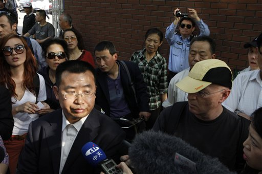 Human rights activist Jiang Tianyong speaks to journalists outside a hospital after his failed attempt to see blind Chinese activist Chen Guangcheng.