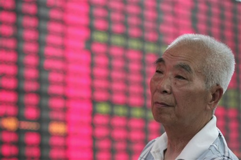 An investor looks at the stock price update on a monitor at a private securities company in Shanghai, China, Tuesday May 22, 2012. Hopes China will announce new measures to boost economic growth helped push Asian stock markets higher Tuesday. (AP Photo)