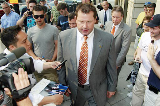 After signing autographs, former Major League Baseball pitcher Roger Clemens leaves federal court on Thursday in Washington.