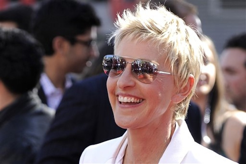 "In this May 26, 2010 file photo, Ellen DeGeneres arrives at the ""American Idol"" finale in Los Angeles. DeGeneres, who broke ground in 1997 by playing the first lead character on primetime TV to reveal sheís gay, is winning the nationís top humor prize. The Kennedy Center in Washington is announcing Tuesday that DeGeneres will receive the 15th annual Mark Twain Prize for American Humor. She will be honored Oct. 22 with a lineup of star performers. (AP Photo/Chris Pizzello, File) BDAY120123lbox BDAY120123lbox"