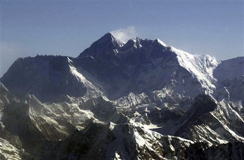 "In this Tuesday, May 6, 2003 file photo, Mount Everest, at 8,850-meter (29,035-foot), the world's tallest mountain situated in the Nepal-Tibet border as seen from an airplane. Days after four people died amid a ""traffic jam"" of climbers scrambling to conquer Mount Everest, Nepal officials said a similar rush up the world's tallest peak will begin soon, and there's little they can do to control it. (AP Photo/Binod Joshi, File)"