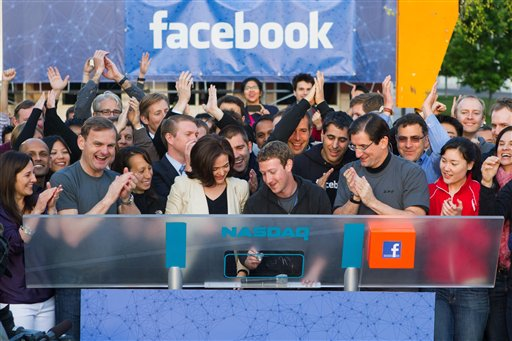 Facebook founder, Chairman and CEO Mark Zuckerberg, center, remotely rings the opening bell of the Nasdaq stock market today from Facebook headquarters in Menlo Park, Calif.
