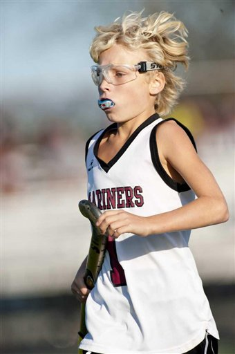 In an Oct. 21, 2011, photo, Keeling Pilaro, 13, is seen on the field as a member of the Southhampton High School Girls Varsity field hockey team in Southhampton, N.Y.