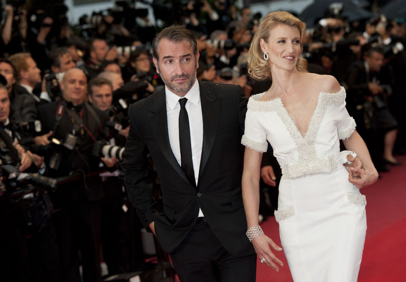 Actor Jean Dujardin, left, and Alexandra Lamy arrive for the awards ceremony at the 65th international film festival, in Cannes, southern France, Sunday, May 27, 2012.