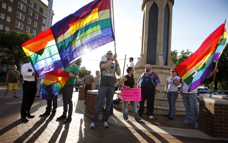 Dale Robinson waves his flag at a rally of the Dallas LGBT Community to applaud President Obama's stance on Gay marriage.
