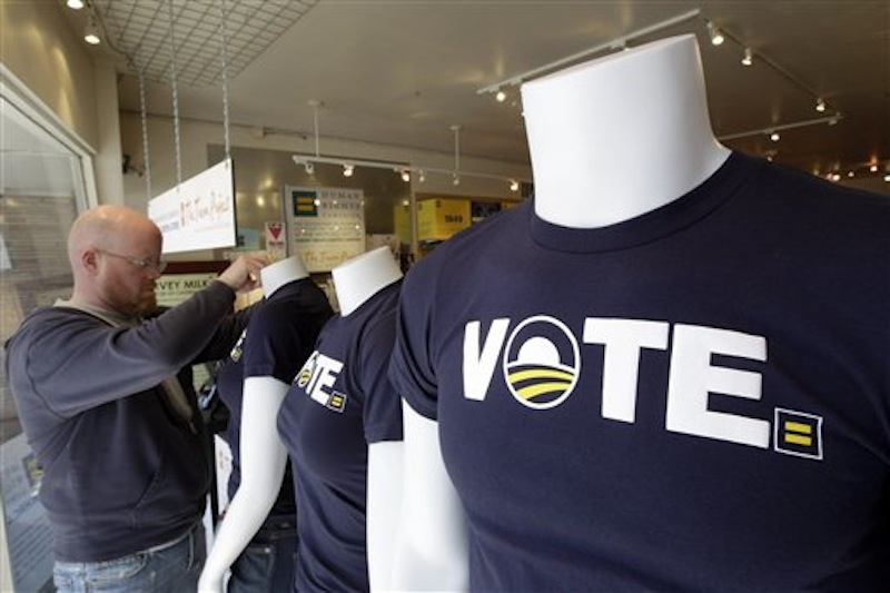 Shane Martin, general manager of the Human Rights Campaign store, dresses mannequins in VOTE Obama t-shirts Wednesday, May 9, 2012, in San Francisco. President Obama today announced Wednesday that he now supports same-sex marriage, reversing his longstanding opposition amid growing pressure from the Democratic base and even his own vice president. (AP Photo/Ben Margot)