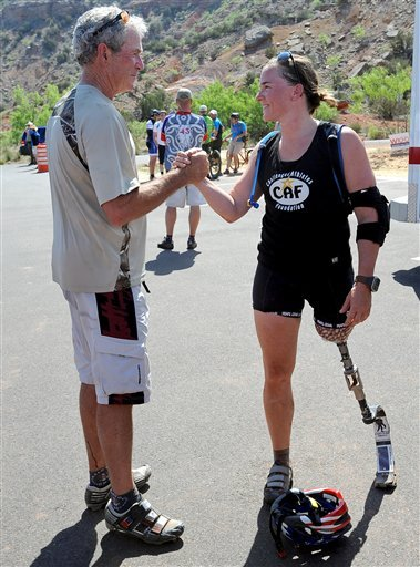 Former President George W. Bush shakes hands with retired U.S. Army 1st Lt. Melissa Stockwell at the end of the Bush Center Warrior 100K Race at Palo Duro Canyon State Park in Amarillo, Texas, on April 26. Bush hosted the 100-kilometer mountain bike ride for military members wounded in Iraq and Afghanistan.
