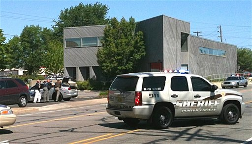 Police surround a real estate office Friday in Valpariso, Ind., where they say a gunman is holding an unknown number of hostages. The Associated Press