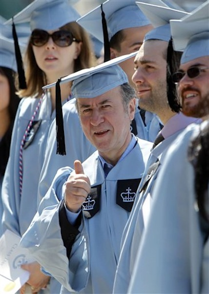 Columbia University janitor Gac Filipaj give a thumbs up during the Columbia University School of General Studies graduation ceremony, Sunday, May 13, 2012, in New York. Filipaj, 52, an ethnic Albanian who left his native Montenegro 20 years ago to escape war, is graduating with honors after 12 years of balancing studies and his full-time job. (AP Photo/Jason DeCrow)