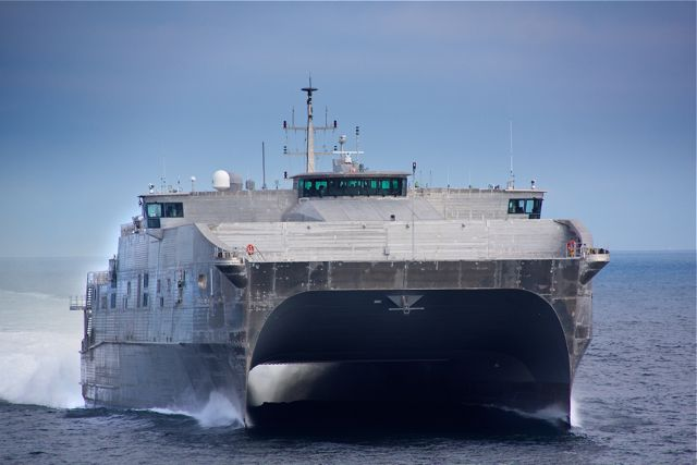 The high-speed catamaran transport ship USS Spearhead, the first ship in the JHSV class that will include the USS Millinocket, is shown here undergoing sea trials on April 19 by shipbuilder Austal in the Gulf of Mexico. The Millinocket, which has an identical design, is under construction and scheduled for christening in January.