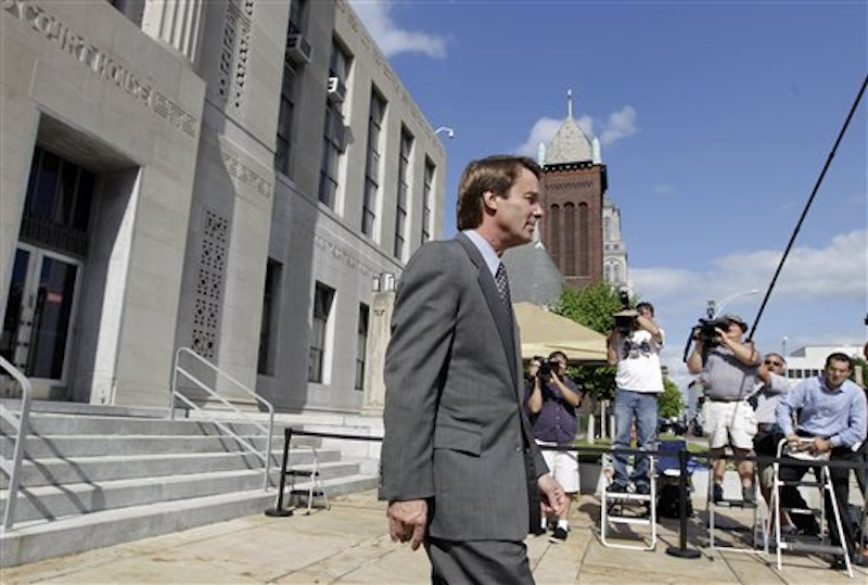 Former presidential candidate and Sen. John Edwards leaves a federal courthouse in Greensboro, N.C., Monday, May 7, 2012. Edwards is accused of conspiring to secretly obtain more than $900,000 from two wealthy supporters to hide his extramarital affair with Rielle Hunter and her pregnancy. He has pleaded not guilty to six charges related to violations of campaign-finance laws. (AP Photo/Chuck Burton)