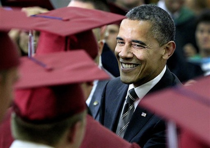 President Barack Obama greets students before the Joplin High School commencement, a day before the anniversary of the twister that killed 161 people, Monday, May 21, 2012, in Joplin, Mo. Obama jetted to Joplin to deliver the commencement address immediately after wrapping up the national security-focused NATO conference in Chicago, the second international summit the president hosted over the past four days. (AP Photo/The Kansas City Star, Rich Sugg, Pool)