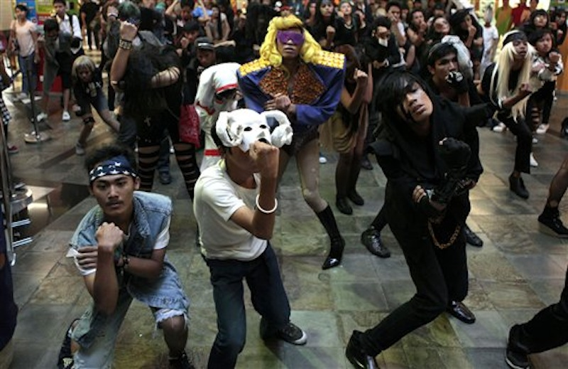 Fans of U.S. pop star Lady Gaga perform a flash mob at a shopping mall in Jakarta, Indonesia, Sunday, May 27, 2012. Lady Gaga canceled her sold-out show in Indonesia after Islamist hard-liners threatened violence, claiming her sexy clothes and provocative dance moves would corrupt the youth. (AP Photo/Dita Alangkara)