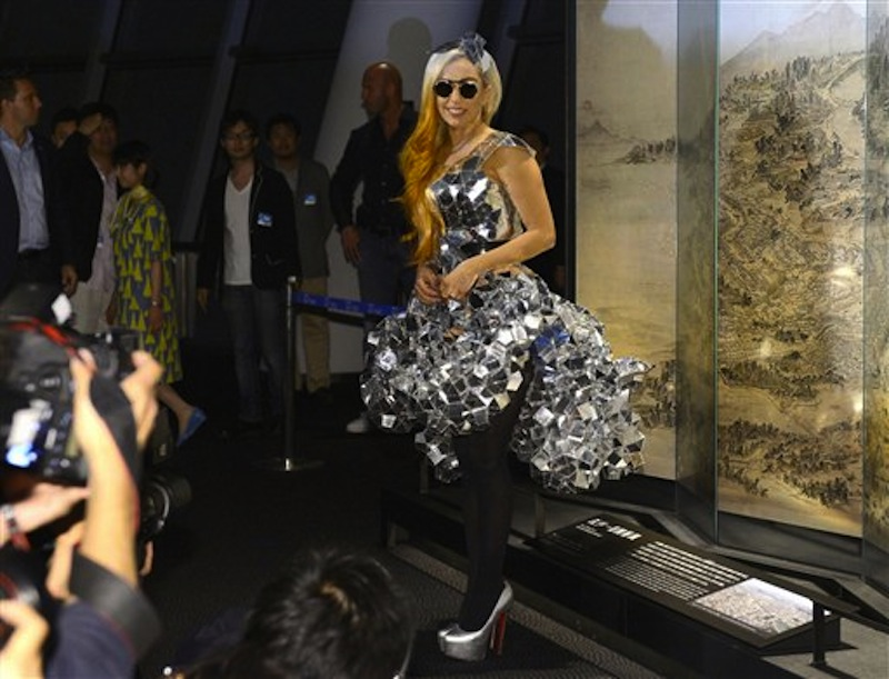Lady Gaga poses as she visits the Tokyo Sky Tree, the world's tallest freestanding broadcast structure that stands 634-meter (2,080 feet), in Tokyo Tuesday, May 15, 2012. Lady Gaga has to cancel her sold-out show in Indonesia because Islamic hard-liners and conservative lawmakers objected. National police spokesman Boy Rafli Amar said the permit was denied for the June 3, 2012,