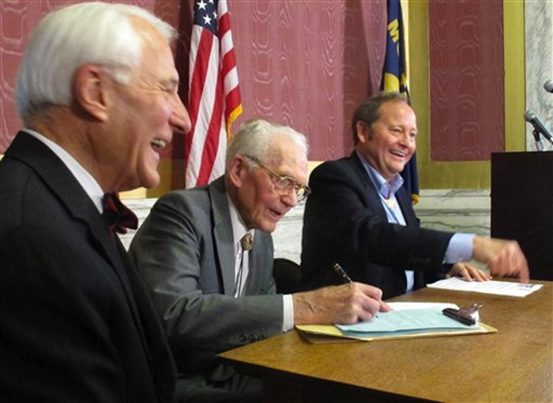 Montana Lt. Gov. John Bohlinger, left, former secretary of state Verner Bertelsen, center, and Gov. Brian Schweitzer on Thursday, May 3, 2012, show thier support for a proposed ballot initiative that says state policy is that corporations are not people and do not have constitutional rights, during a news conference in Helena, Mont. (AP Photo/Matt Gouras)