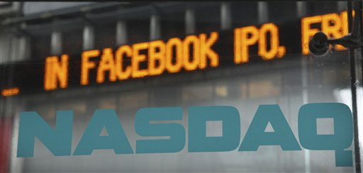 News about the Facebook IPO passes on a billboard outside of NASDAQ in Times Square, New York on Tuesday.