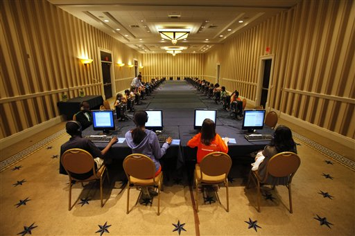 Contestants in the National Spelling Bee take the written exam on computers in Oxon Hill, Md., on Tuesday. The oral competition begins today.