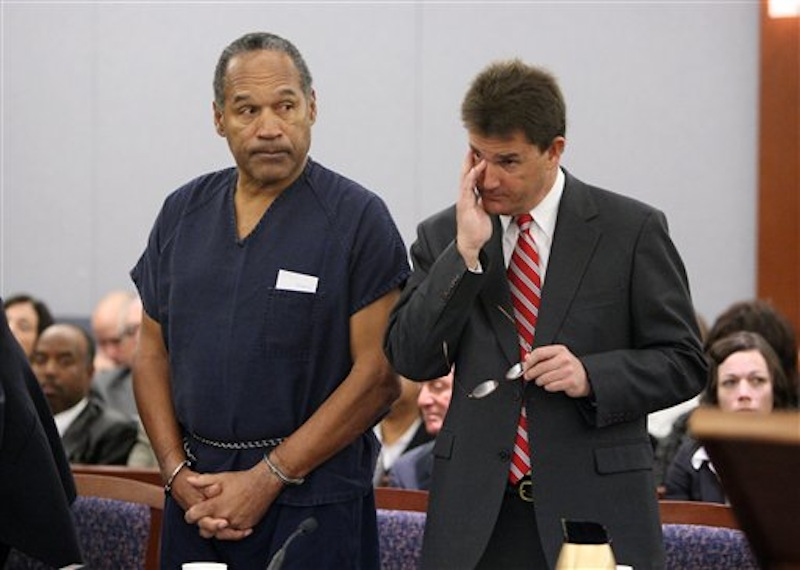 In this Dec. 5, 2008, file photo, O.J. Simpson, left, and his lawyer Yale Galanter appear during his sentencing hearing at the Clark County Regional Justice Center in Las Vegas. Simpson did not have a stroke in prison, according to the Department of Corrections, despite reports to the contrary. (AP Photo/Isaac Brekken, Pool, File)