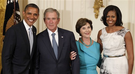 President Barack Obama, former President George W. Bush, former first lady Laura Bush and first lady Michelle Obama pose in the East Room of the White House today during a ceremony to unveil the Bushes' portraits.