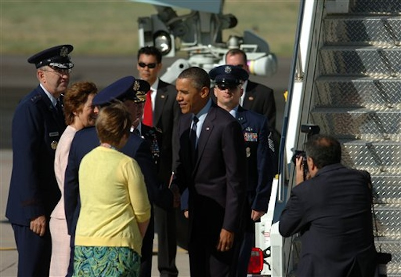 President Barack Obama greets dignitaries after he arrived on Air Force One at Peterson Air Force Base, Colo. on Wednesday, May 23, 2012. Obama will deliver the commencement speech to the Air Force Academy graduates. (AP Photo/Bryan Oller)