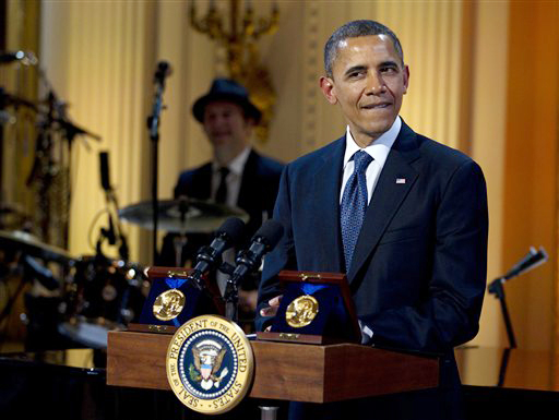 """President Barack Obama pauses as he speaks during the """"In Performance at the White House"""" on Wednesday, honoring songwriters Burt Bacharach and Hal David, recipients of the 2012 Library of Congress Gershwin Prize for Popular Song."""