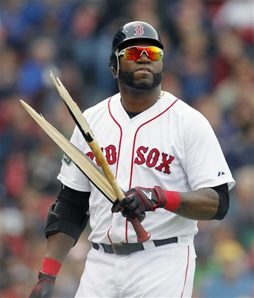 Boston Red Sox's David Ortiz walks back to the dug out with a broken bat after lining out in the eighth inning of a baseball game against the Baltimore Orioles in Boston, Saturday, May 5, 2012. (AP Photo/Michael Dwyer)