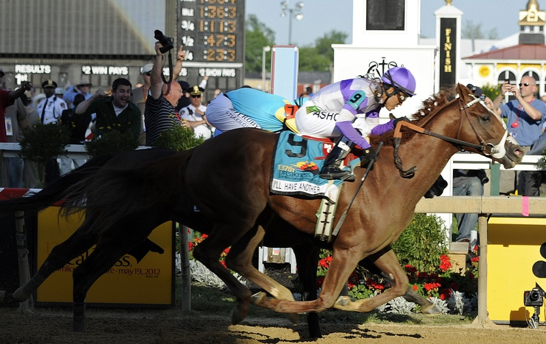 I'll Have Another (9), ridden by Mario Gutierrez, beats Bodemeister, ridden by Mike Smith, to the finish line to win the 137th Preakness Stakes horse race at Pimlico Race Course on Saturday.